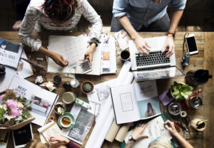 Family using the dinner table as a shared work space gets messy