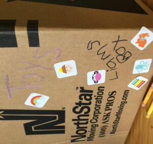 kids can color and decorate their moving boxes