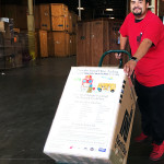 Loading food drive donations onto a NorthStar Moving truck