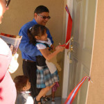 Family opens the front door of their new home
