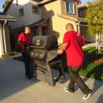 Movers moving a BBQ