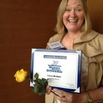 Laura McHolm, Co-Founder and Director of Marketing at NorthStar Moving with her award at the reception!