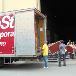 Community members load the NorthStar Moving truck